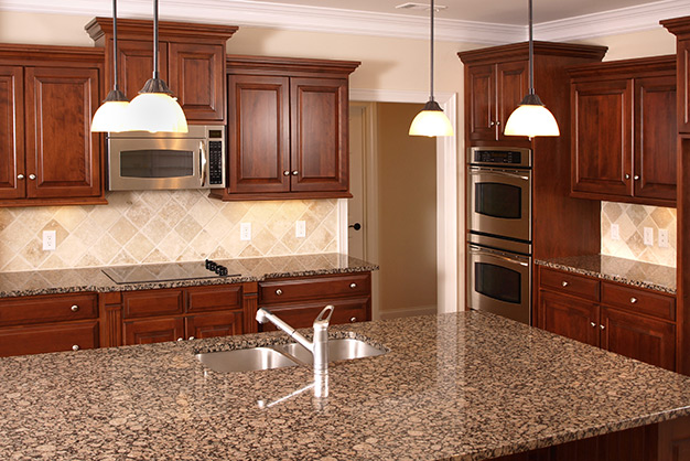 brown-granite-countertops-plymouth-cabinetry-design-wisconsin